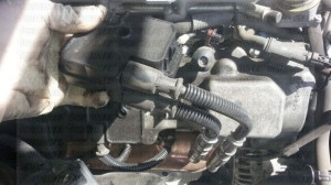 After undoing the bolt, pull off your ignition coil and transfer your ignition wires to the new replacement coil.